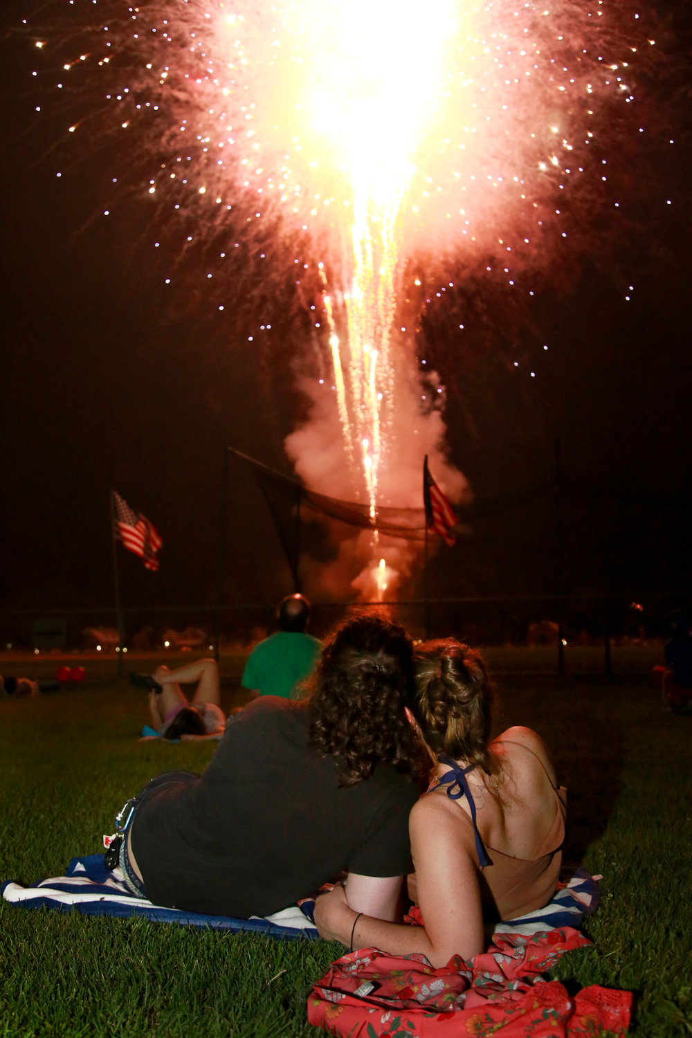 Peter Belfiore and Bridget Downes watched the fireworks light up the night sky.