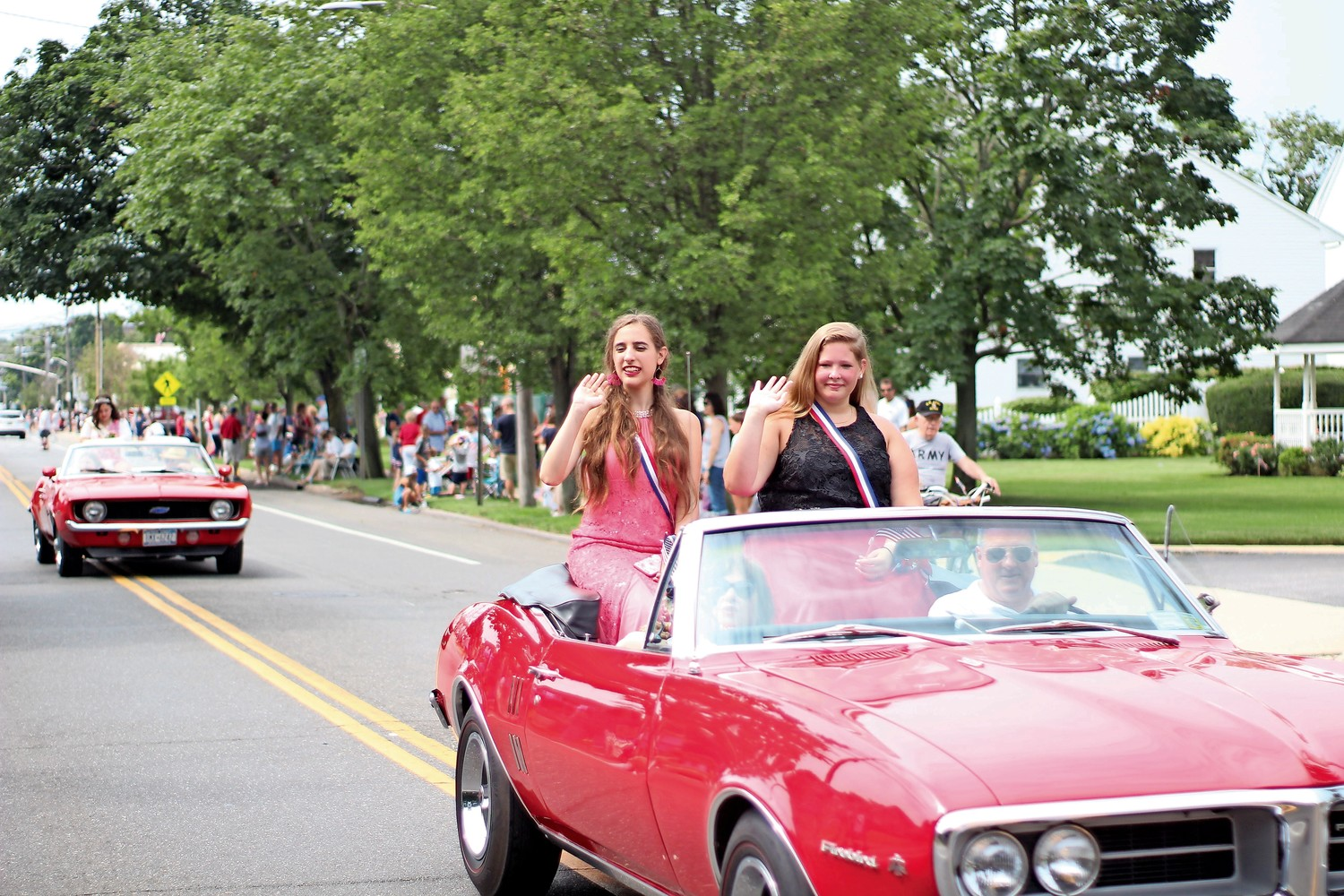 Before she was crowned Miss Wantagh, Ashley Bailey, right, rode in the Wantagh Fourth of July parade with future Ambassador Marisa DeVito.