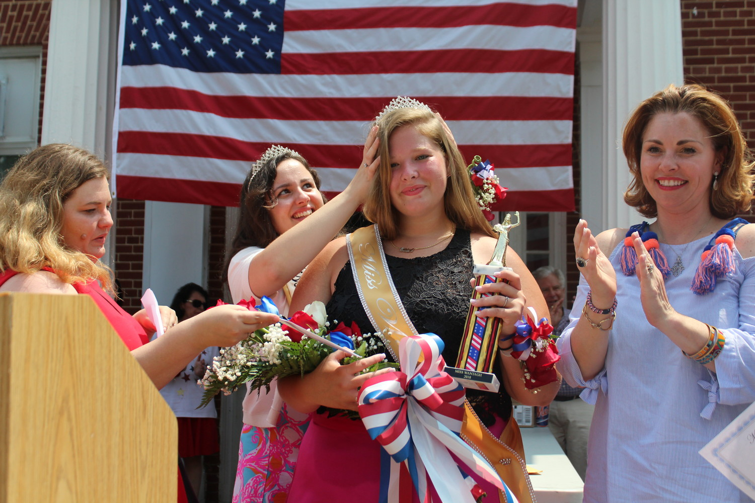 Ashley Bailey, a Wantagh High School and Gerald R. Claps Technical Center student, was crowned Miss Wantagh on July Fourth. Samantha Walsh, Miss Wantagh 2017, helped fix her tiara, while Town of Hempstead Councilwoman Erin King Sweeney, right, celebrated with her.