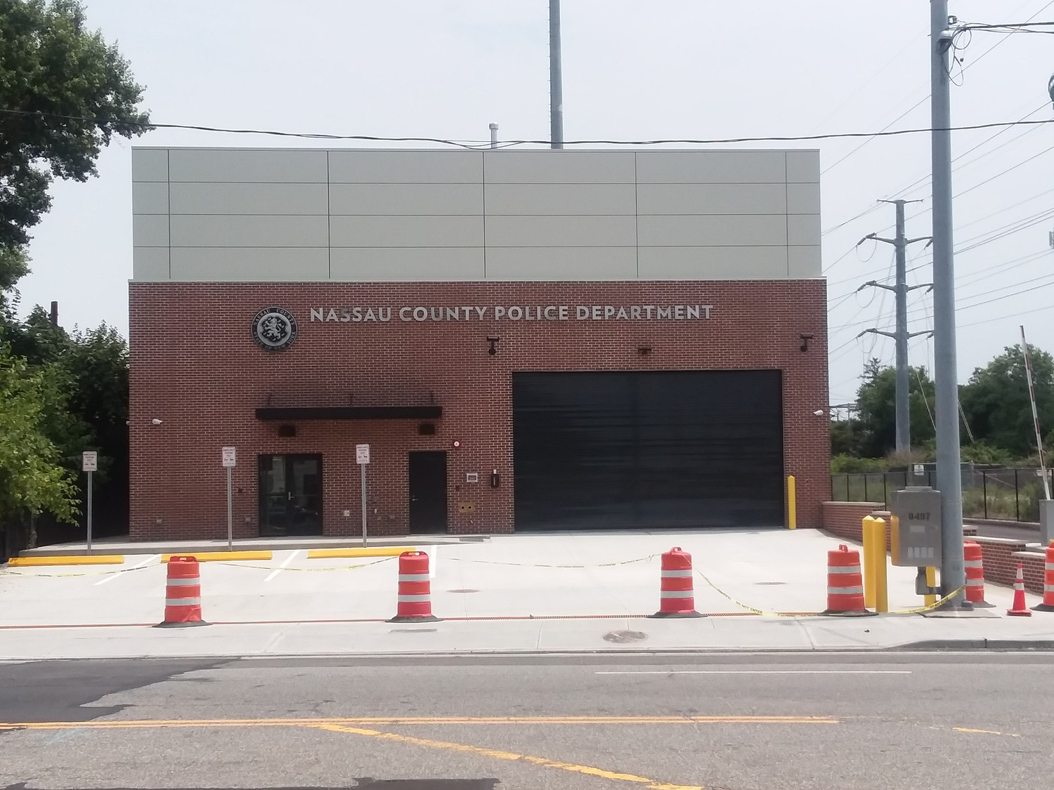 A new state-funded building houses the (8th) Community Policing Center. The new visitor's parking lot is not yet open as of July 4.