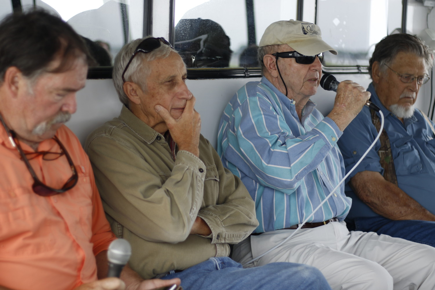 "Bob Doxsee's bay house was transported from Point Lookout to Meadow Island. Doxsee, with mic, was joined in a tour of the houses by Dennis Carr, left, Frank ""PJ Passalaqua and Jack Combs."