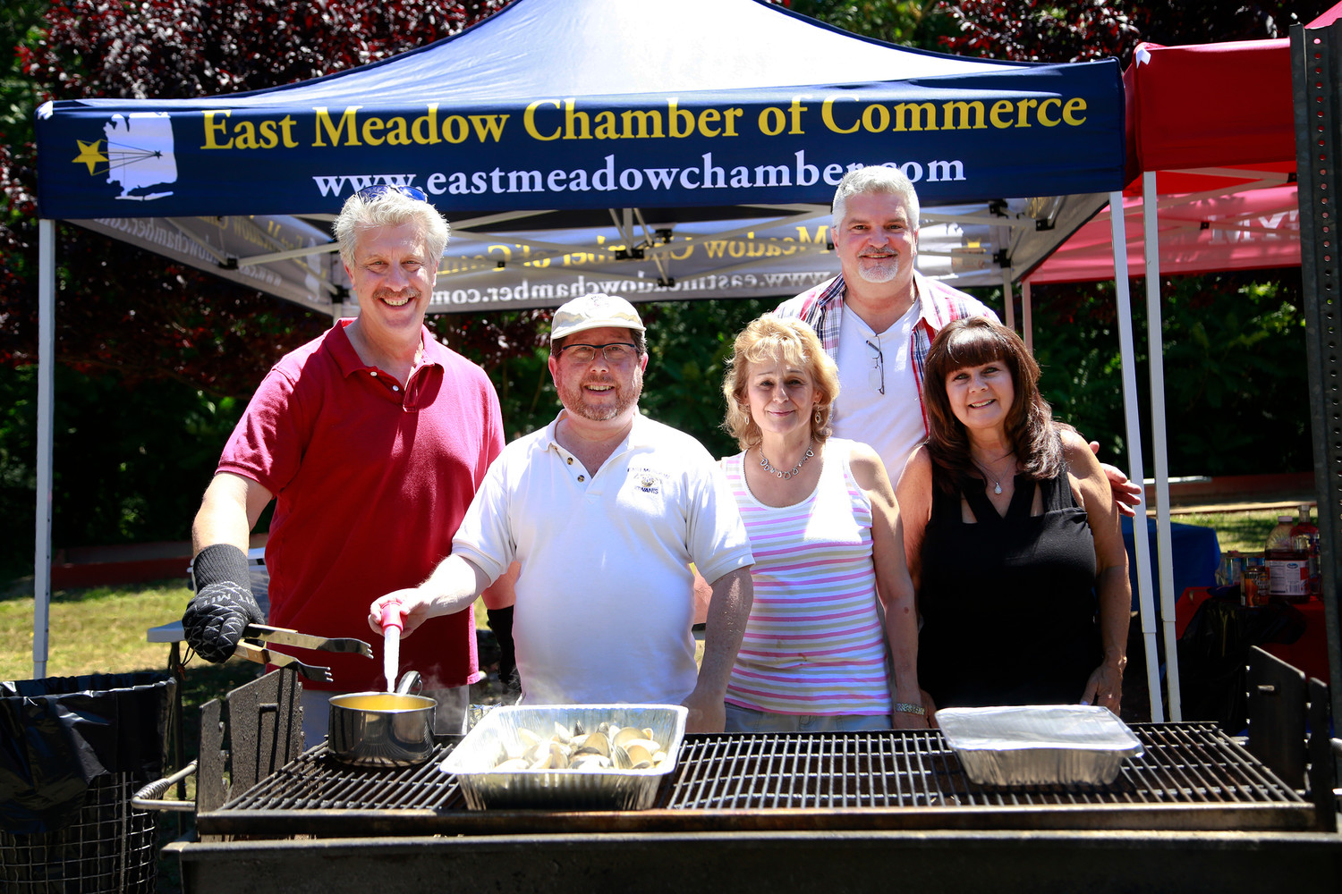 Jay Steinmetz, left, Eric Vogel, Liz Fries, Frank Camarano and Debbie Kirsh, the picnic's co-chairs, were responsible for feeding more than 100 guests, but they also made time to enjoy some clams themselves.