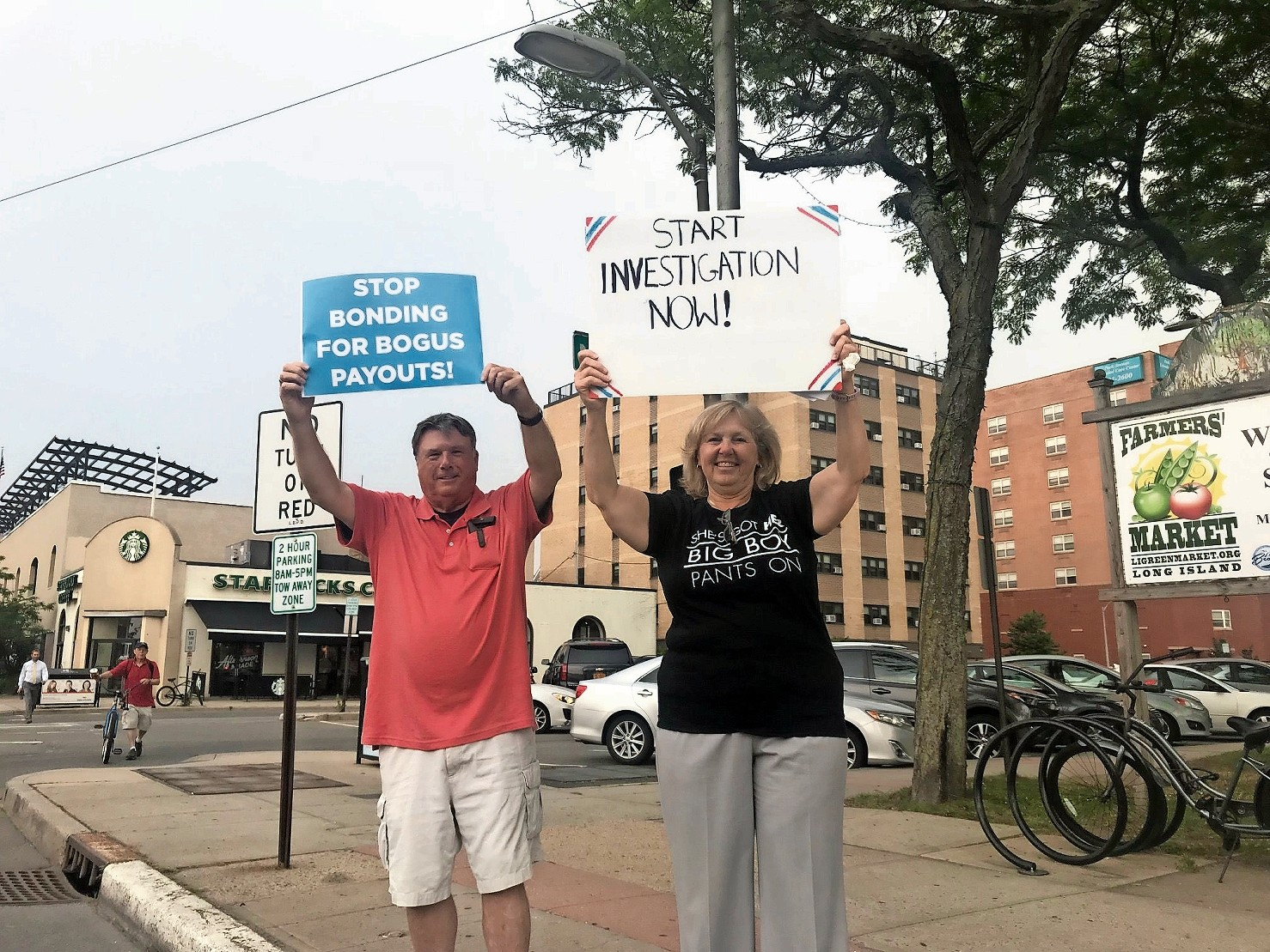 Bill Tansey and Nassau County Legislator Denise Ford at a protest outside City Hall on July 3 calling for an investigation into recent payouts to a number of employees, including former City Manager Jack Schnirman.