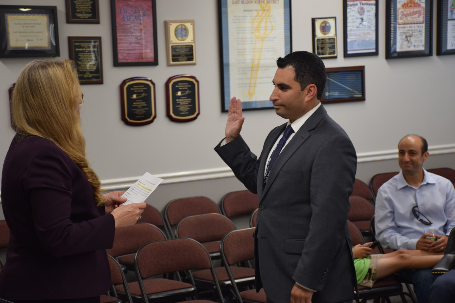 Matthew Melnick, right, was sworn in as newly elected president of the East Meadow Board of Education with Scott Eckers being voted vice president.