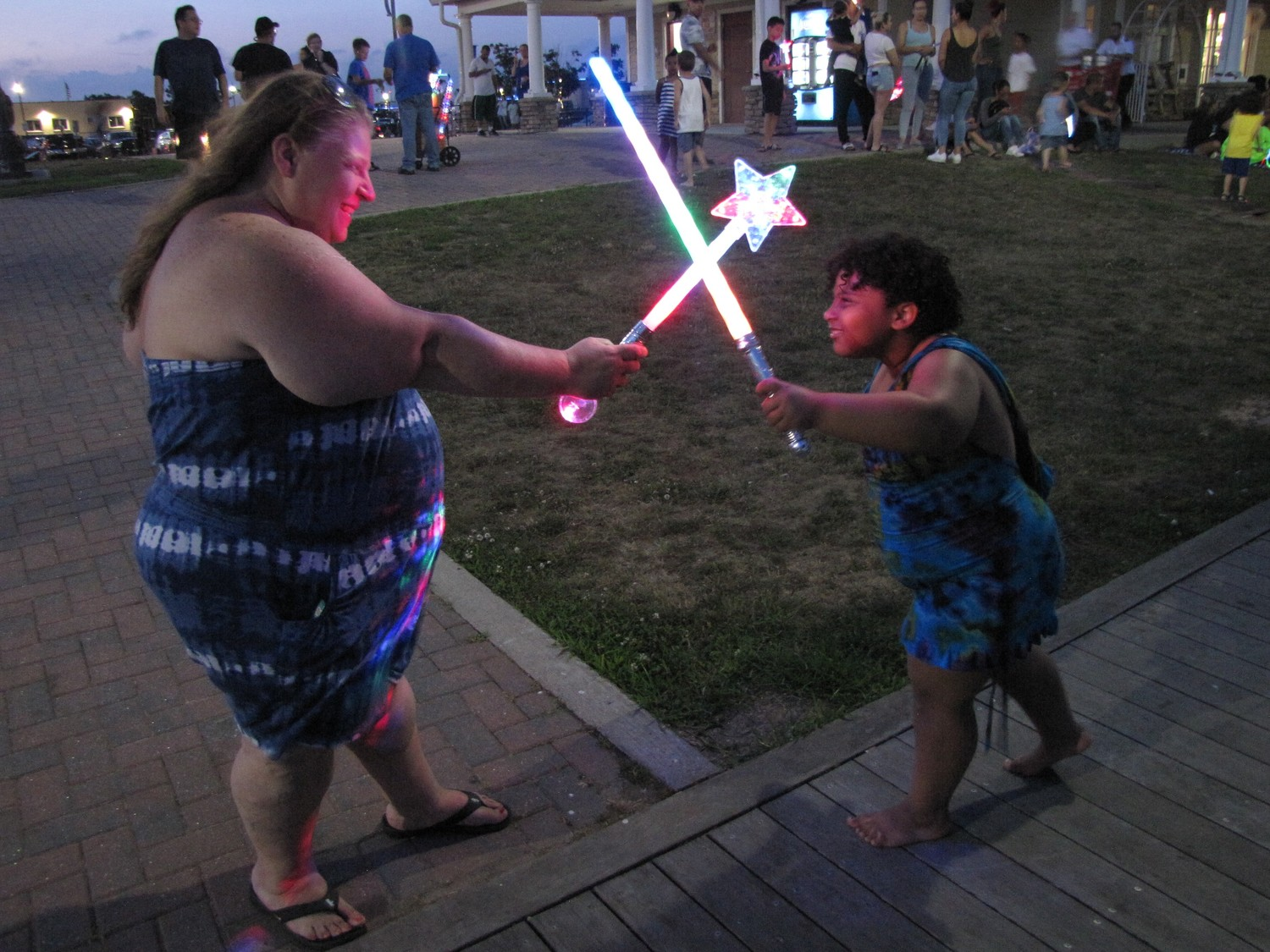 Before the fireworks started, mother and daughter Kristin and Ariella Wagner, of Freeport, played with their glow-in-the-dark swords.