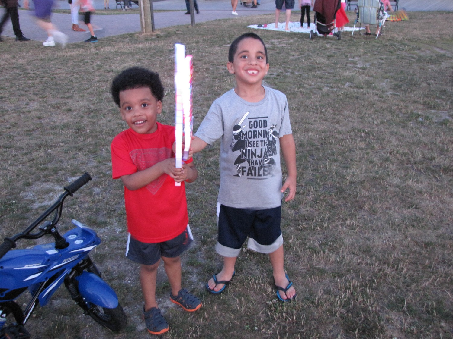 Becoming fast friends, Mason Bovere, near left, and Geovany Lora met at Sea Breeze Park before the fireworks show.