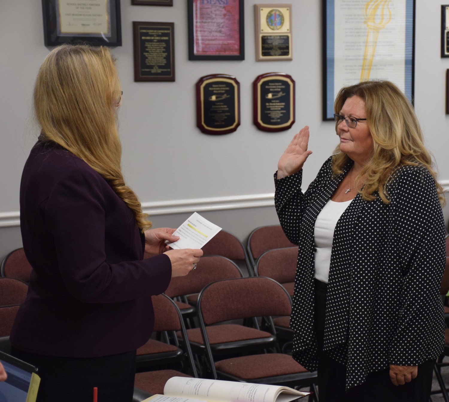 Eileen Napolitano, right, was sworn in as the newest member of the East Meadow Board of Education during its annual reorganization meeting on July 5.