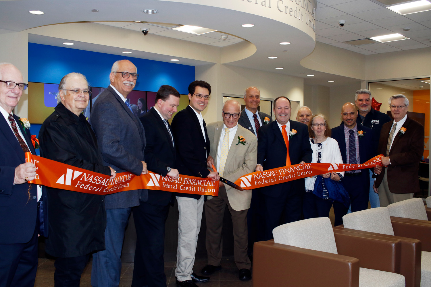 The NFFCU celebrated its grand opening in a new location in East Meadow on May 19 with a ribbon cutting hosted by the East Meadow Chamber of Commerce.