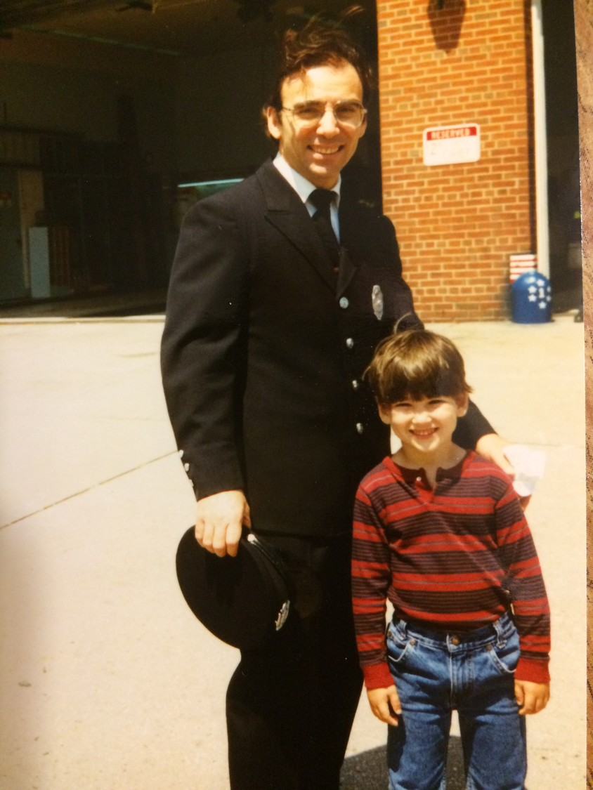 Freeport firefighter Joseph Primavera with his son Joey in the late 1980s. Primavera is celebrating five decades with the Fire Department.