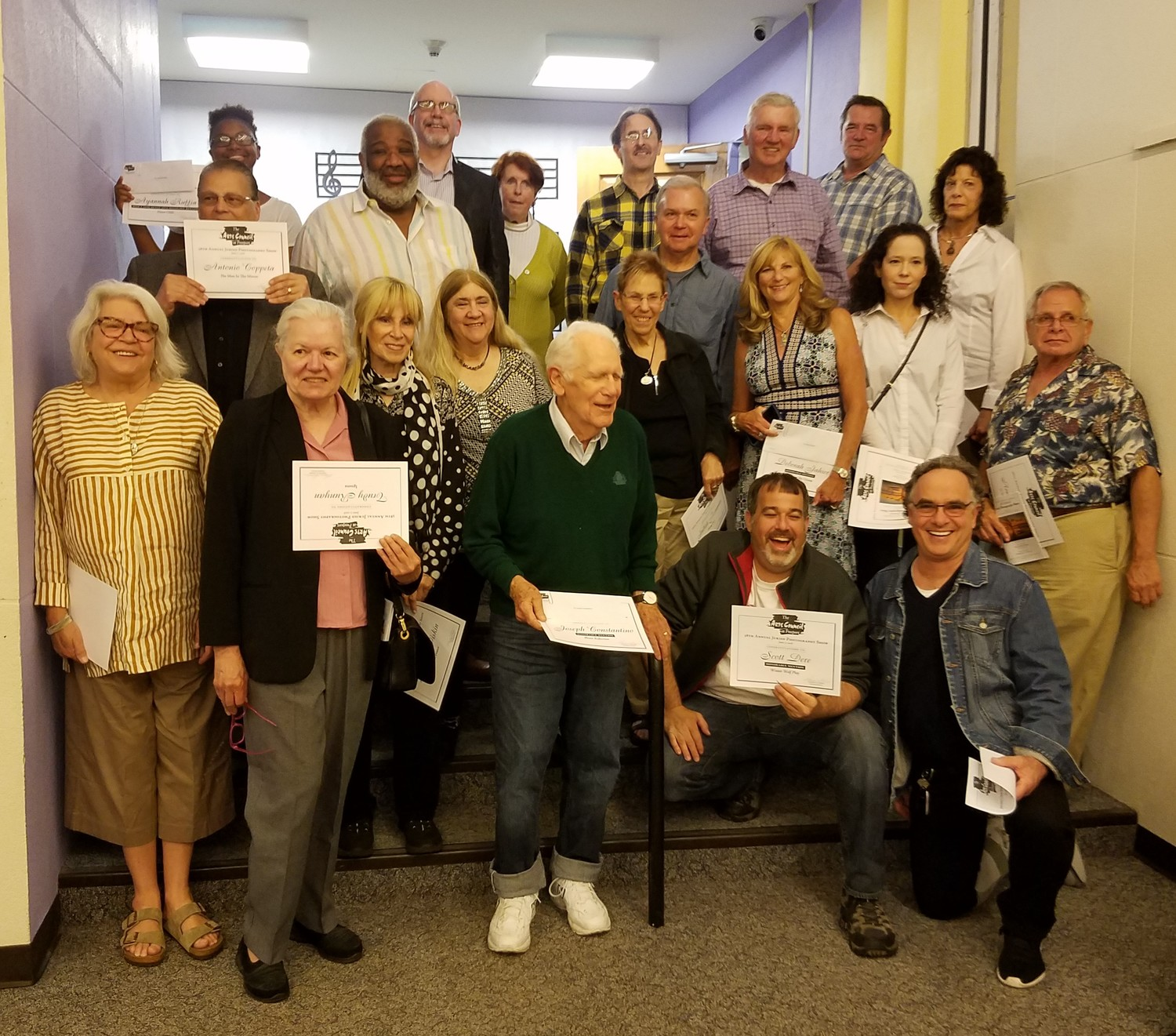 The 38th annual Juried Photography Show winners and honorable mentions showed off their certificates after the awards and artists reception at the Freeport Memorial Library.