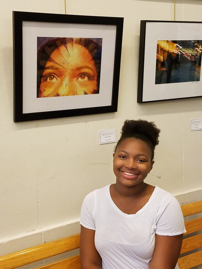 "Winning honorable mention, Ayannah Ruffin, was all smiles in front of her photograph ""Flower Child."""