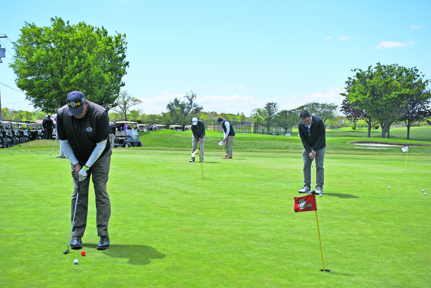 The Town of Hempstead is investigating the possibility of making the Woodmere Club land a town park or a park district. Above, putting practice at last year's Lawrence Woodmere Academy golf outing.