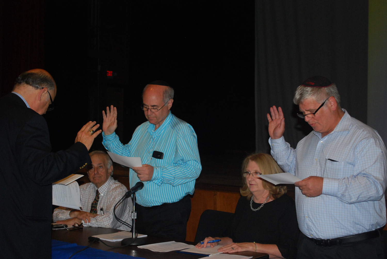 Al D'Agostino, far left, the Lawrence School District attorney, administered the oaths office to Board of Education President Murray Forman, center, and Vice President Dr. Asher Mansdorf. Trustee Dr. David Sussman is at left, and also sitting is Superintendent Dr. Ann Pedersen.