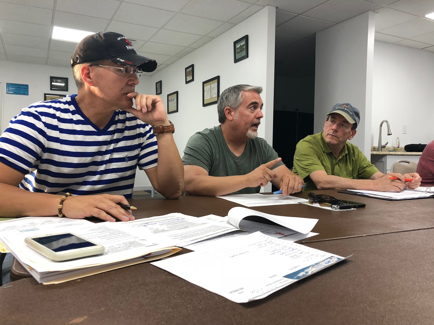 Glen Head residents and NYAW ratepayers Lawrence Ruisi, left, Dan O'Connor and Steve Warshaw were in attendance at the July 5 meeting.