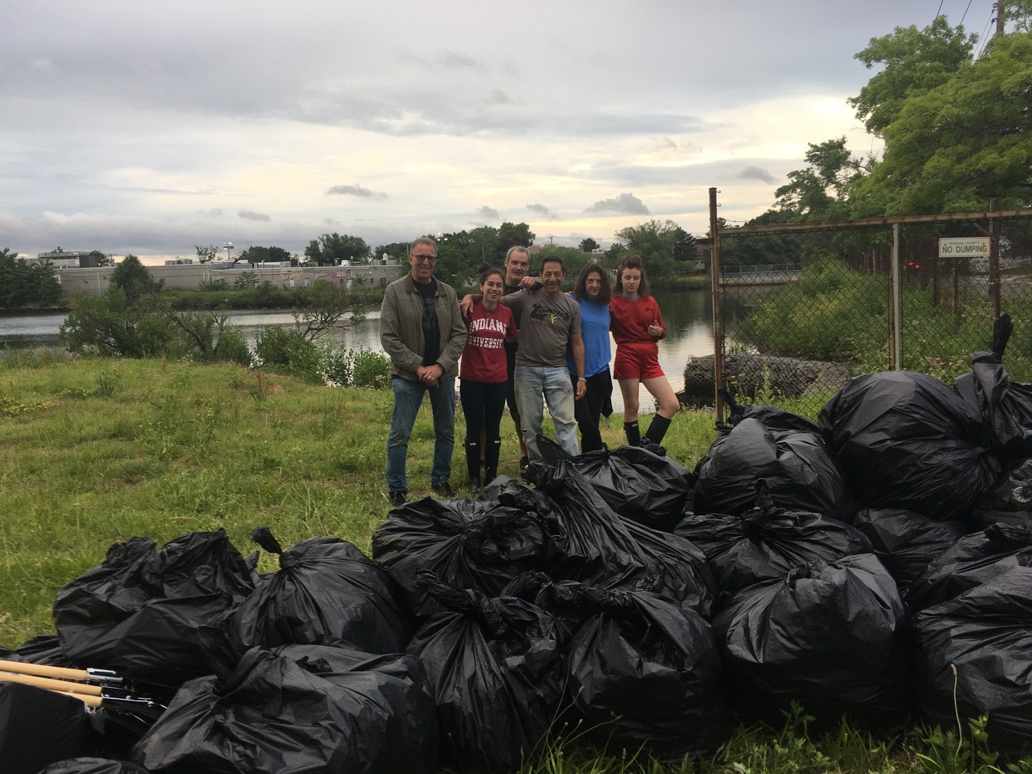 The cleanup yielded more than 60 bags of trash. From left, Ernie Schultz, Carli Feldman, David Augusto, Bob Feldman, Marla Augusto and Casey Augusto.