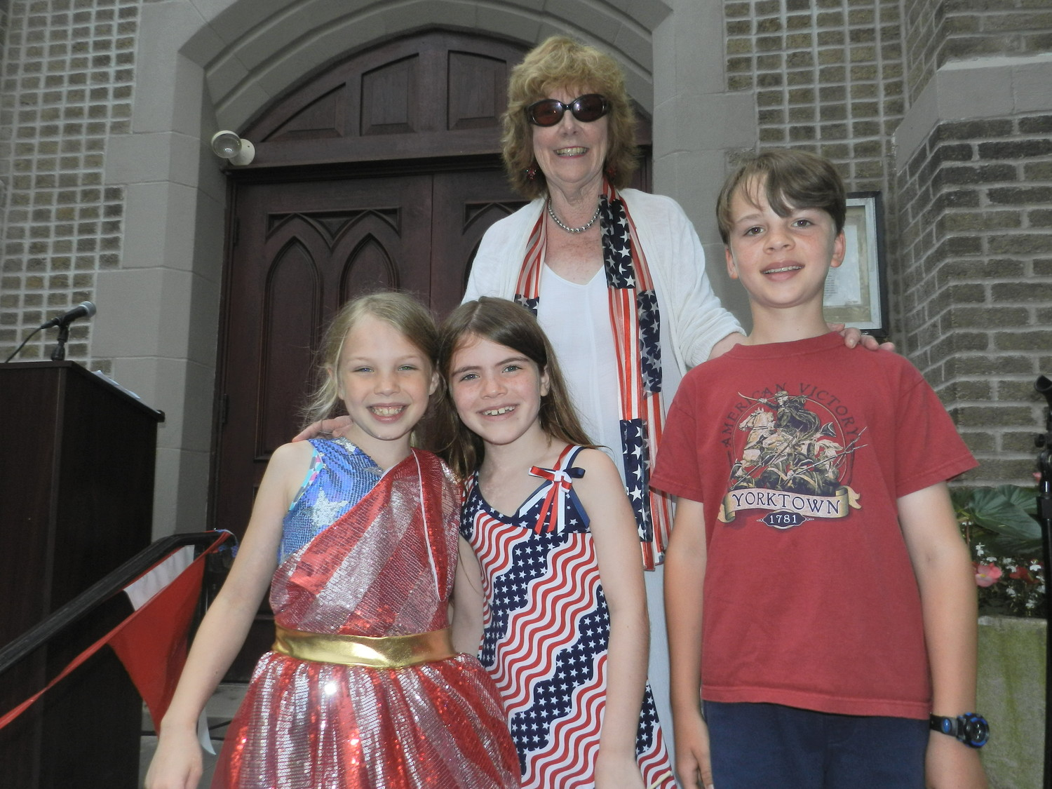 Fiona Hughes, Olivia McCarthy and Graham Lippert, who pretended to be descendants of Declaration of Independence singers, helped Sea Cliff Civic Association President Ann DiPietro by reading passages of the historic document.