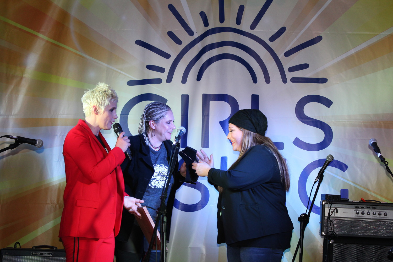 Kristen Ellis-Henderson, left, and Cathy Henderson honor Carnie Wilson of Wilson Phillips with the first-ever Game Changer Award for her commitment to uplifting women. They presented Wilson with a necklace sporting the Girls Rising logo, created by Sea Cliff jeweler and member of the Girls Rising Board of Directors Kathleen DiResta.