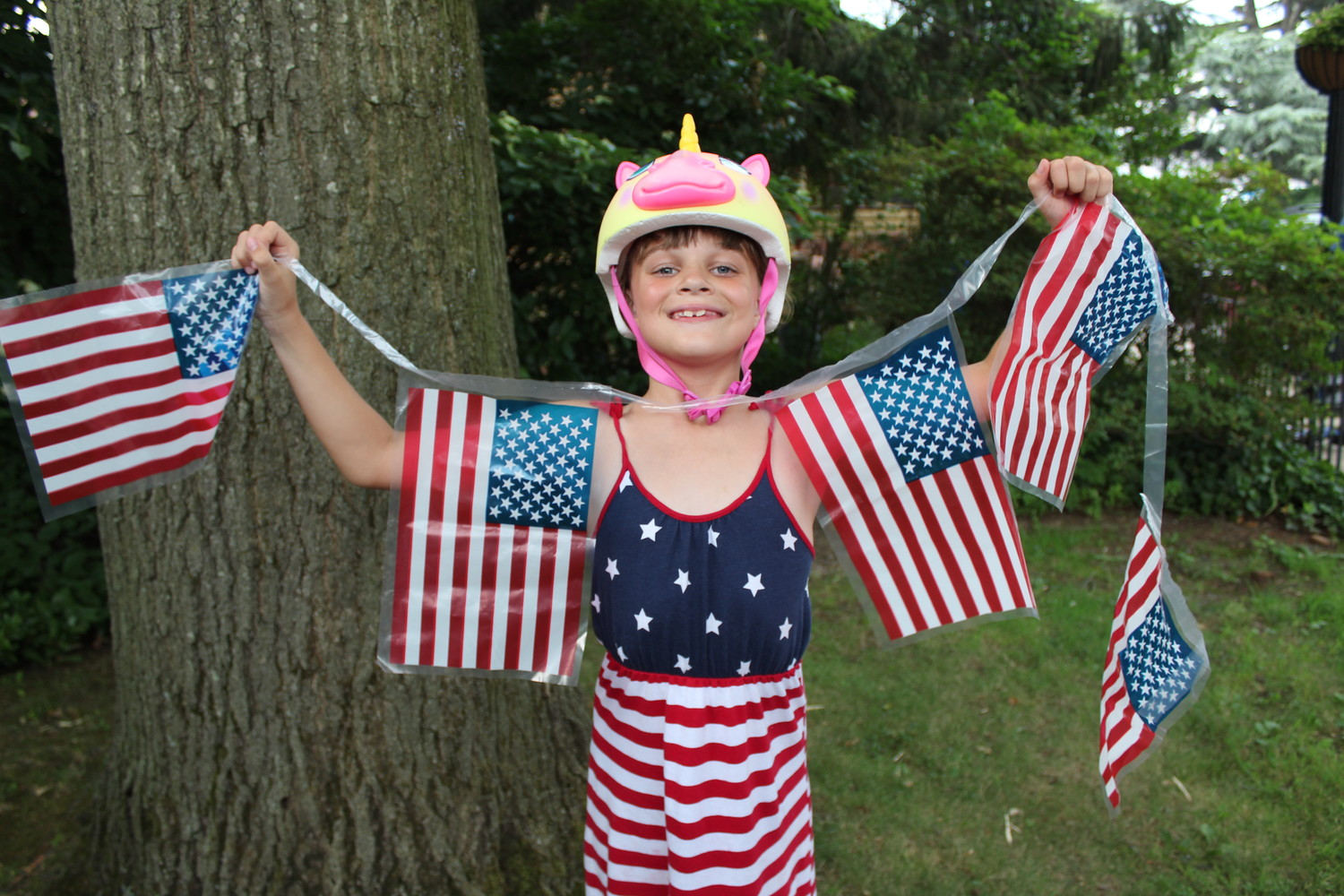 Lucy Jackson proudly held up an American flag banner, which matched her Fourth of July themed sundress.
