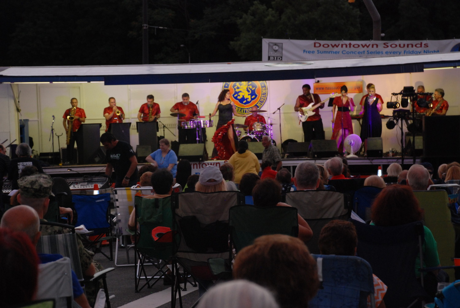 More than 100 people attended the first show in the Downtown Sounds concert series, crowding School Street and Glen Street with lawn chairs, far left.