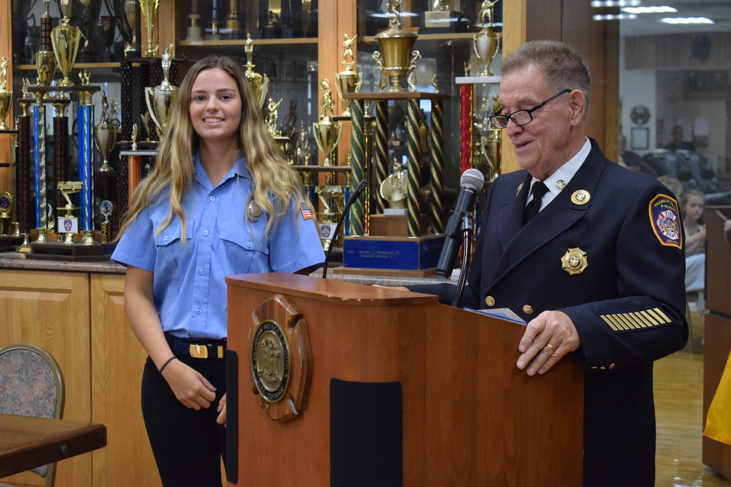 "Dennis Lyons, a Franklin Square & Munson Fire Department commissioner, introduced Daniela Pasquarello, the first recipient of the John ""Jack"" Schilt Memorial Scholarship."