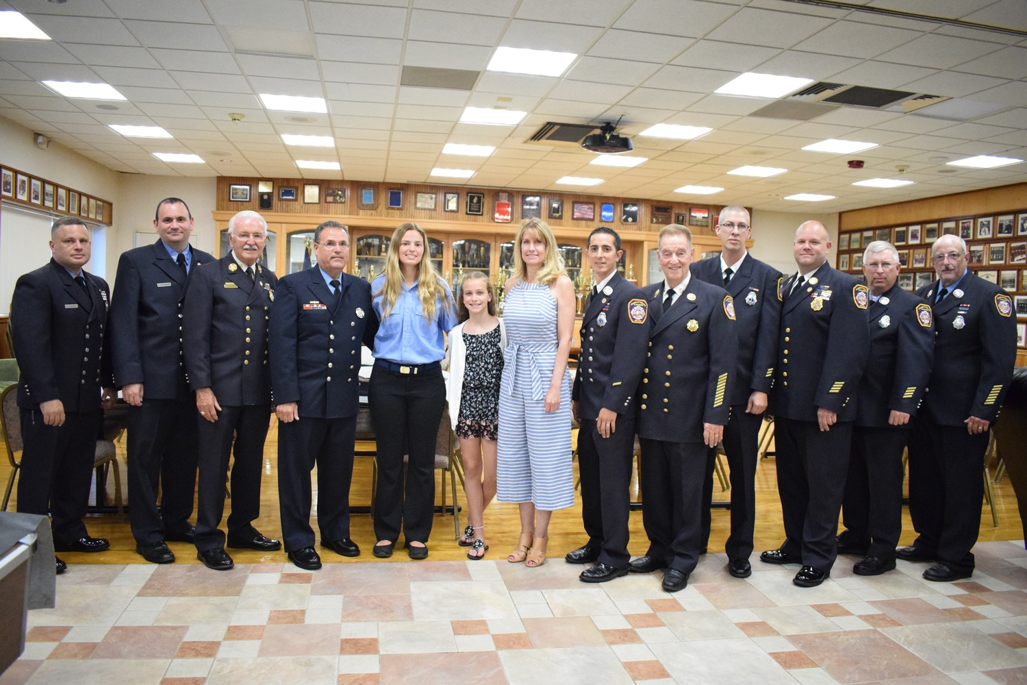 Fire volunteers and veterans celebrated at Daniela Pasquarello's scholarship ceremony, along with the Schilt family.