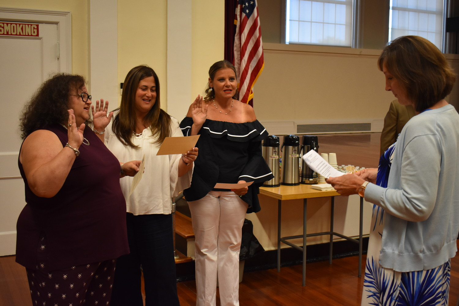 District clerk, Barbara Randazzo, administered the oath of office to the trustees, from left, Melissa Gates, Judy Menashe and Debi Sheinin.