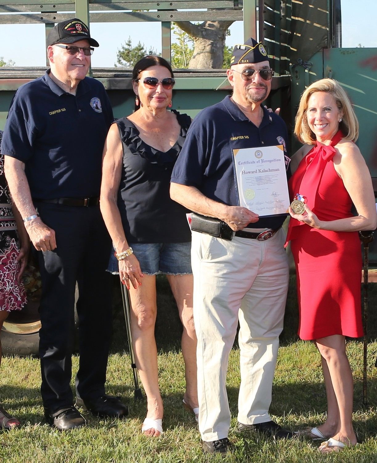Howard Kalachman, second from right, received the Veterans Medal from Town Supervisor Laura Gillen, far right, at the Salute to Veterans on June 30. They were joined by Disabled American Veterans Chapter 145 member James Brown and Kalachman's sister, Marilyn Diamond.