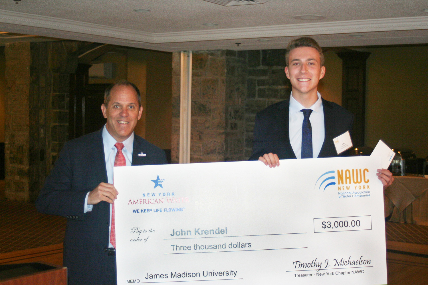 Lynbrook graduate John Krendel, right, recently received a $3,000 scholarship from New York American Water President Carmen Tierno.