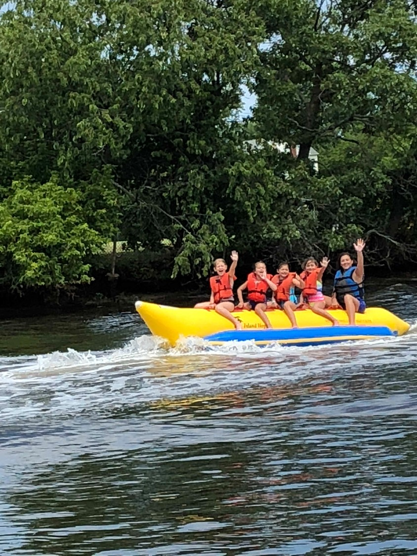 G7 Snappers camp group assistant counselor Brooke Geller, far right, rode with her campers on the banana boat at Rolling River Day Camp.