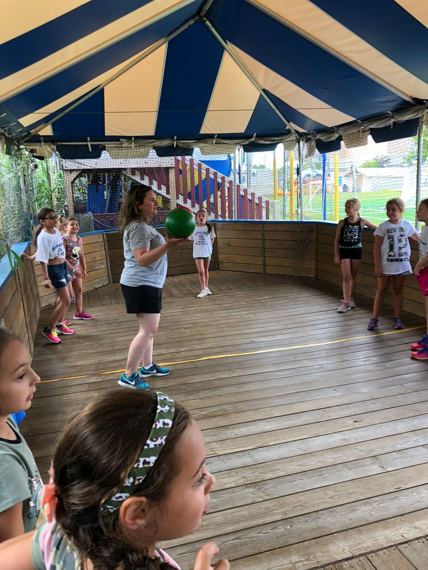 G7 Snappers head counselor Michelle Perlmutter, center, led her campers in a game.