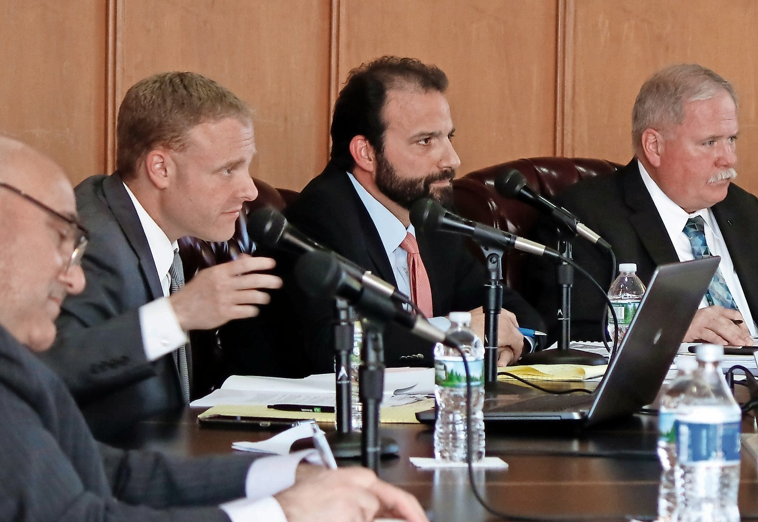 Corporation Counsel Rob Agostisi, second from left, pictured in May, was expected to be named acting city manager at a special City Council meeting last week, but the resolution was not included on the agenda.