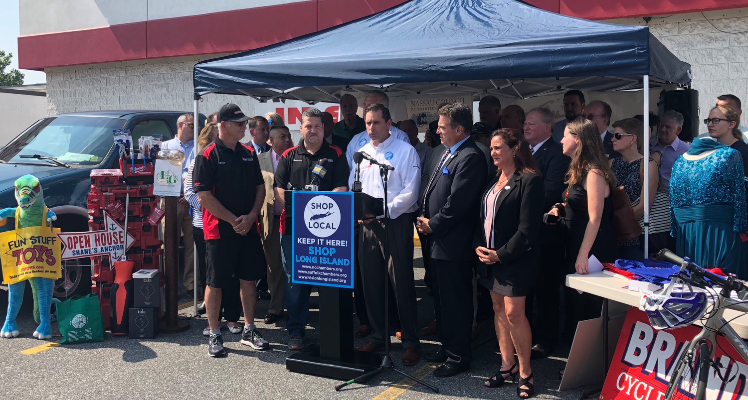 Business owners across Long Island gathered at the P.C. Richard & Son in Plainview on Amazon Prime Day to push for legislation mandating online state sales taxes in New York and to urge online retailers to begin collecting sales taxes.