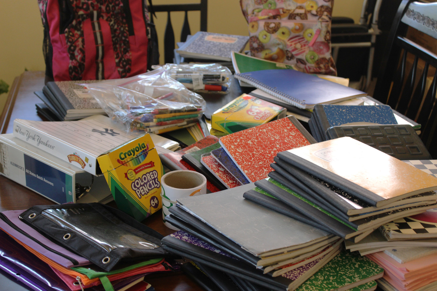 Benowitz has collected close to one hundred new and lightly used notebooks, crayons, two knapsacks and other school supplies.