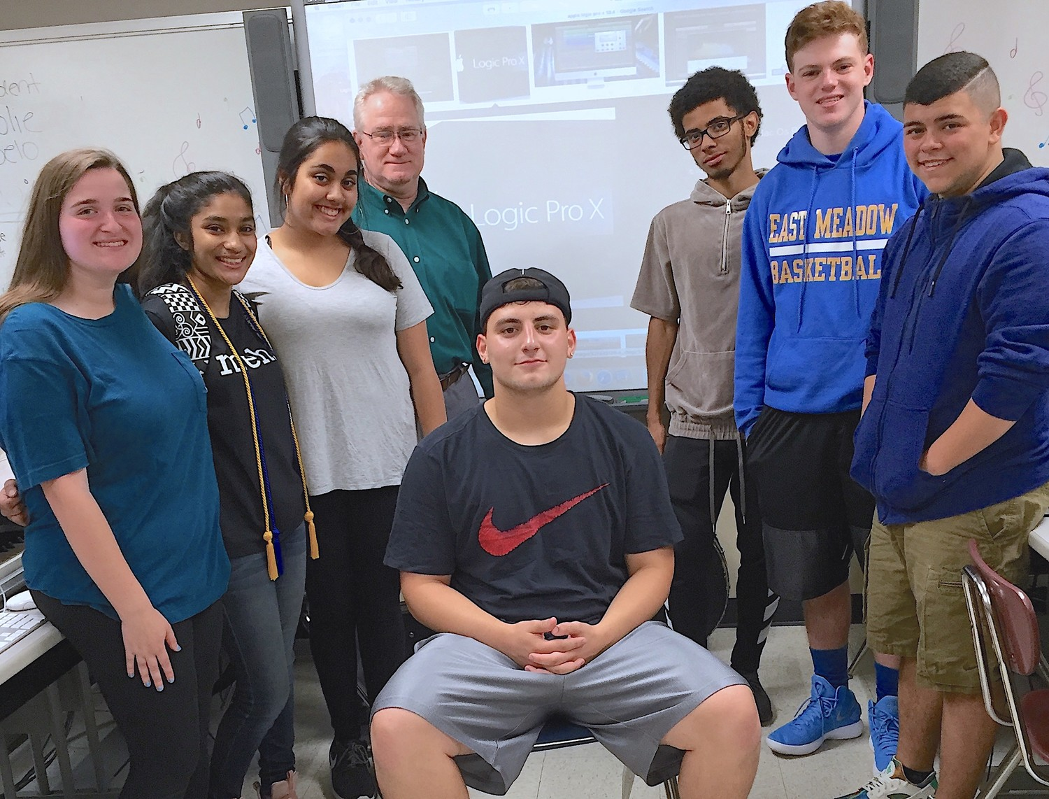 Jessica Rudolph, left, Mehrin Ali, Zahra Lakhani, Domenic Pashalian, Adam Reyes, Evan Haber and Wilmer Mejia, all students at East Meadow High School, earned Apple Logic Pro X certifications this past May. Above they are with their teacher Bill Kinslow.
