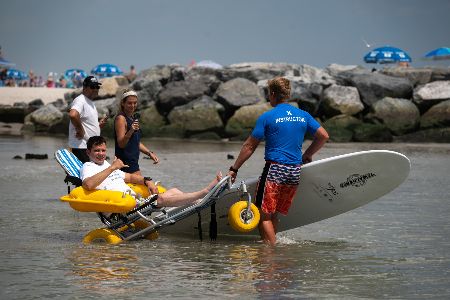 Hofstra University professor and Surf for All athlete Adam Halpern entered the surf with Cliff at the annual outing.