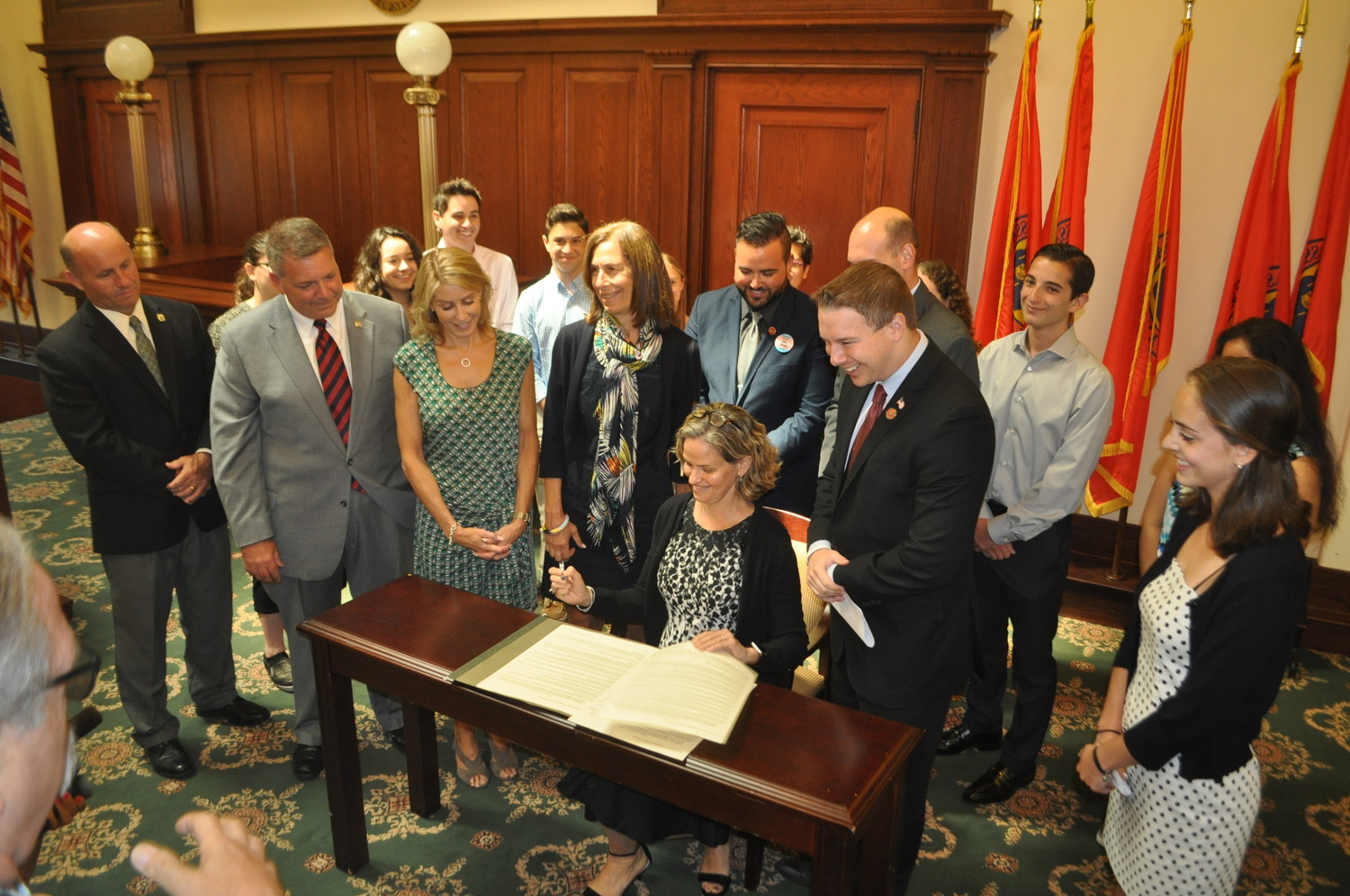 County Executive Laura Curran signed an anti-bullying bill authored by Legislator Josh Lafazan, to her left, surrounded by students and stakeholder organizations.