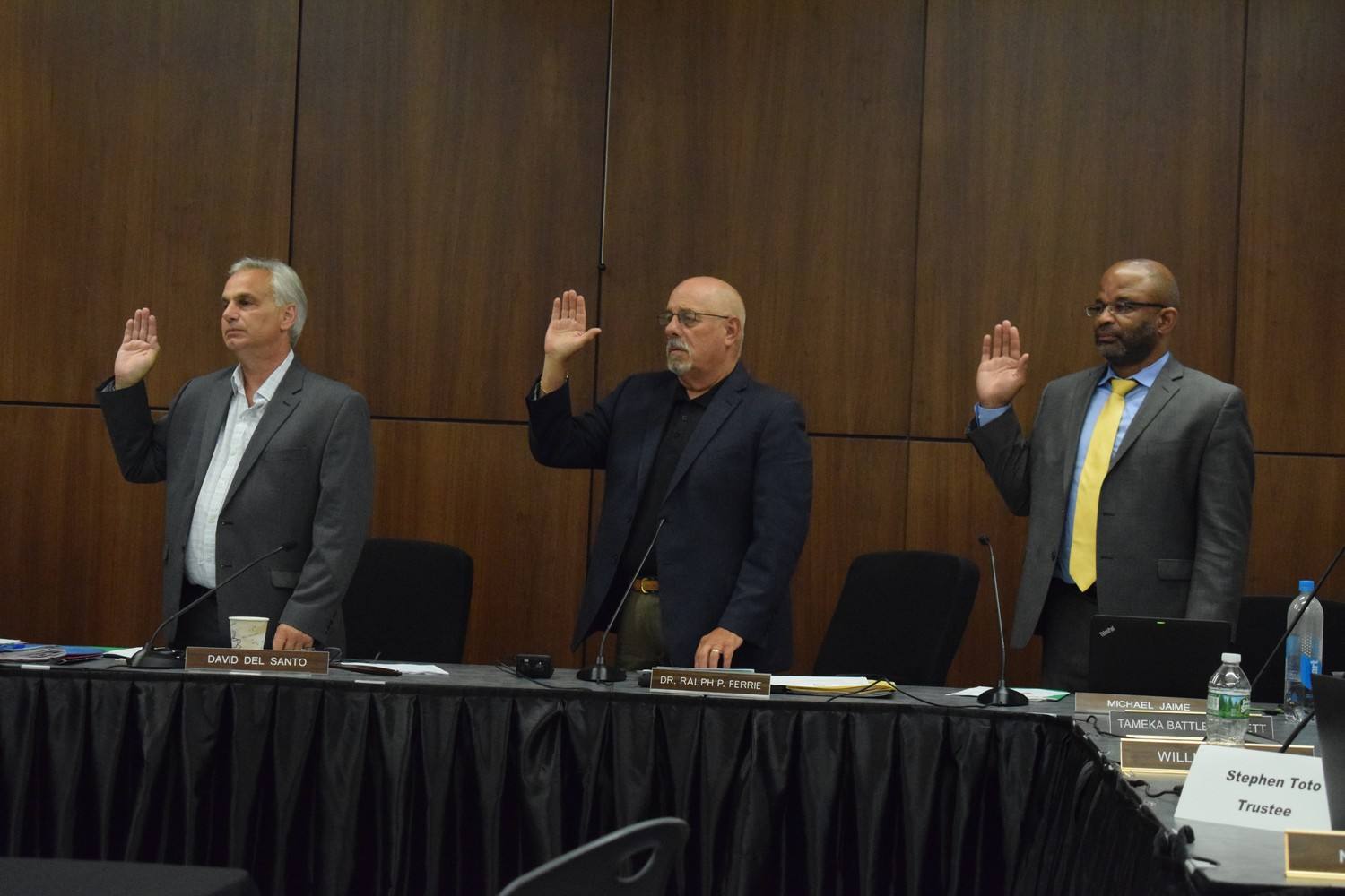 Sewanhaka Central High School District Board of Education President David Del Santo, far left, Superintendent Ralph Ferrie and Vice President Michael Jaime renewed their oaths to serve the district during the July 9 reorganization meeting. This was the last swearing-in for Ferrie, who announced he would retire next summer.