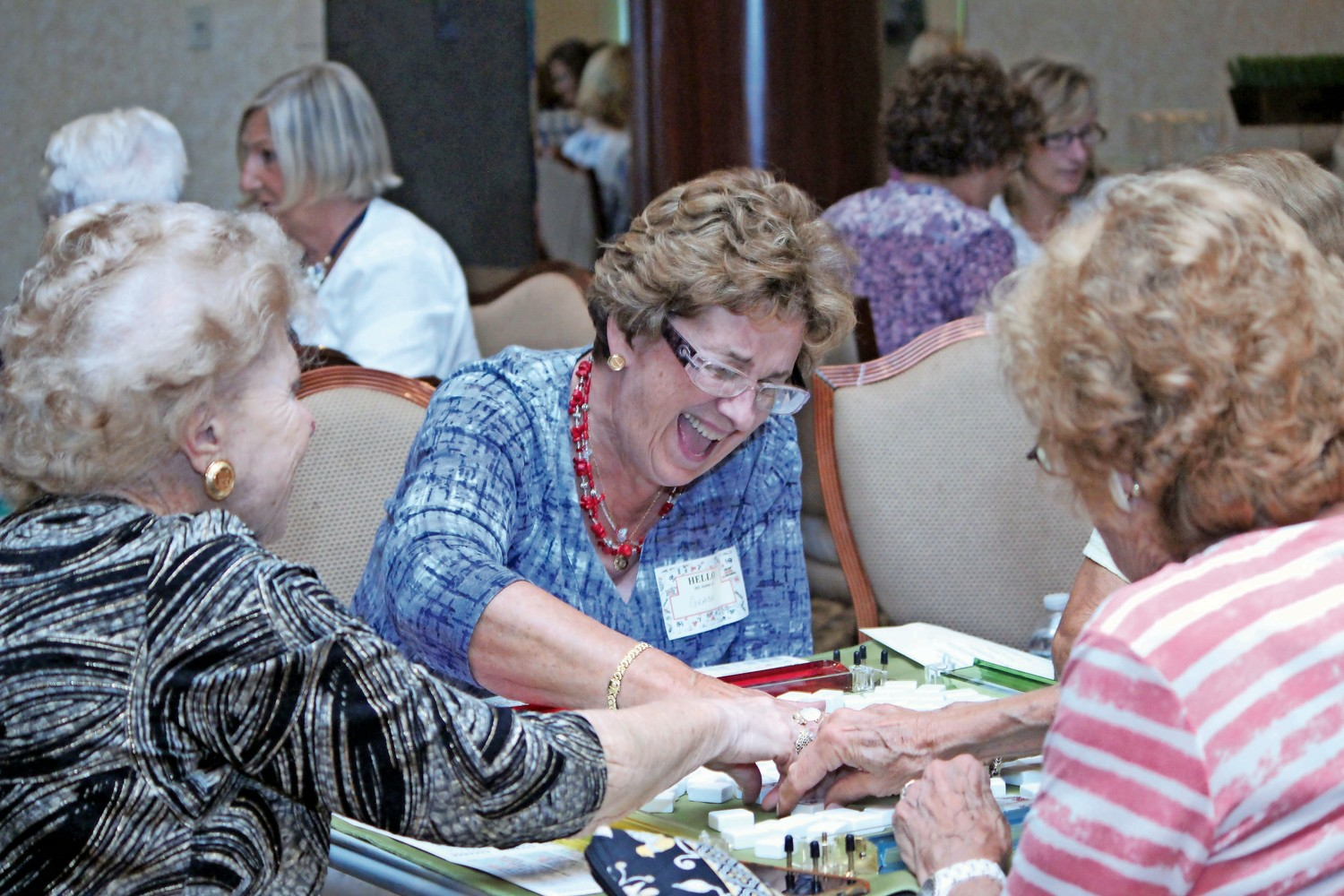 Grace Hatton, center, had a good laugh with her friends Jean Pellegrino, left, and Connie Kearns during B'nai Sholom-Beth David's Mahjongg Game Night last year.
