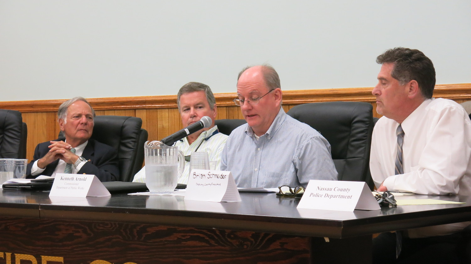 Bayville Mayor Bob De Natale, left, and Mill Neck Mayor Peter Quick listened carefully to the county's plans shared by Ken Arnold.