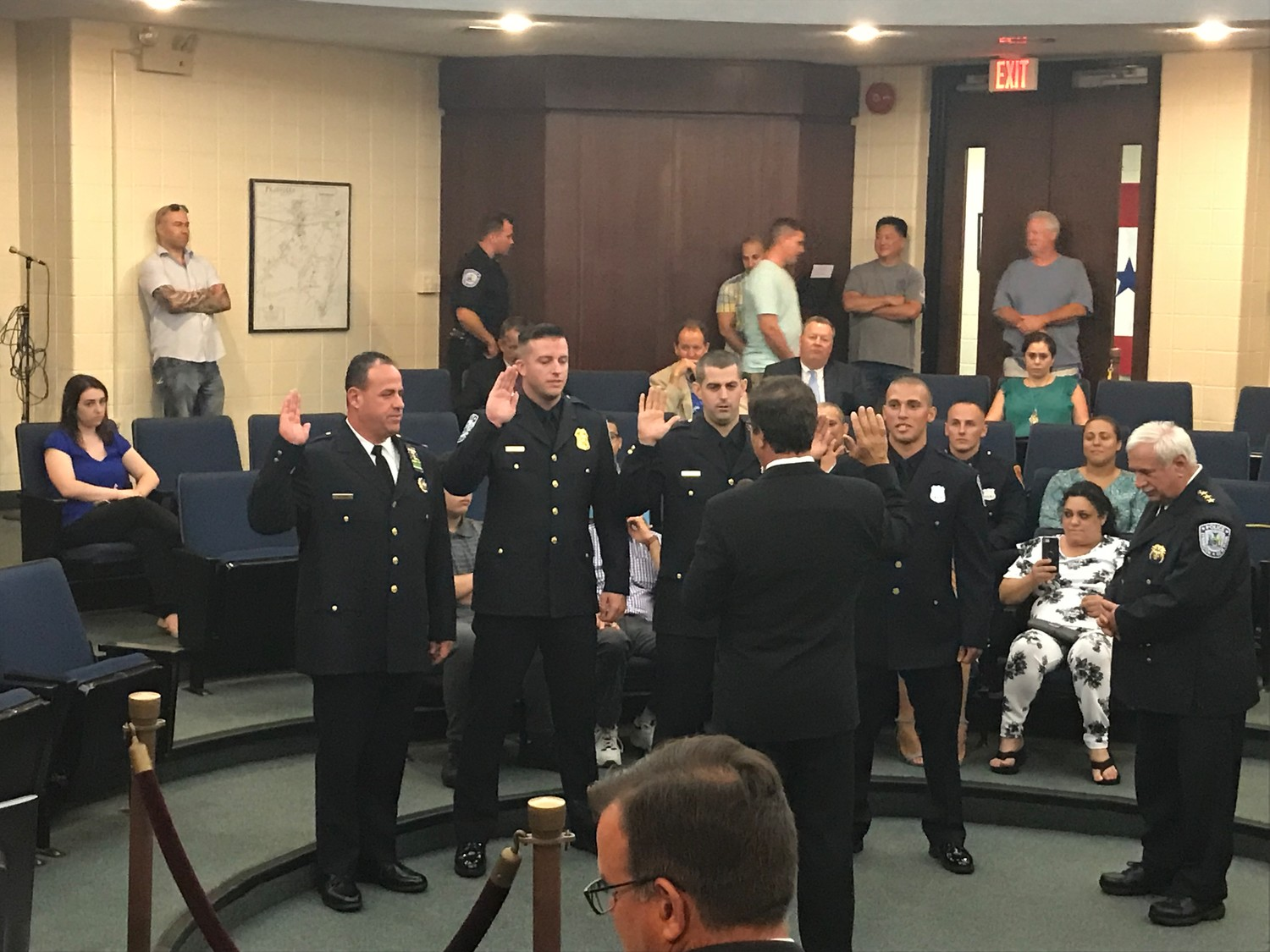 Mayor Alan Beach swore in four police officers to new positions at a meeting on July 16. From left, Brian Paladino was promoted to lieutenant, Sean Haffey became sergeant, Robert Leonard made detective and Jean-Claude James joined the force.