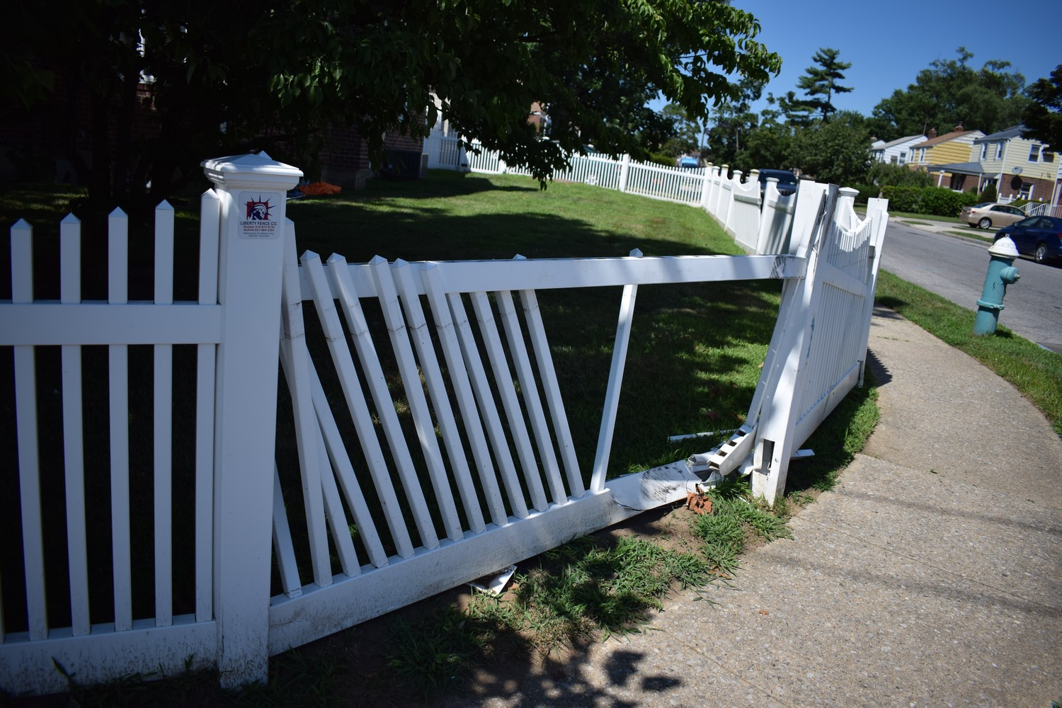 A car slammed into the fence of a home along Dutch Broadway in late June. A police officer said this was the fifth auto incident he had responded to at that location.