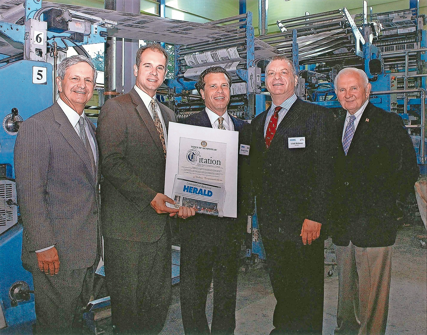 Former Town Supervisor Richard Guardino, far left, Town Councilman Ed Ambrosino, Stuart and Cliff Richner, and former Valley Stream Mayor Ed Cahill in 2007 at the grand opening reception of Richner Communication's new building in Garden City.