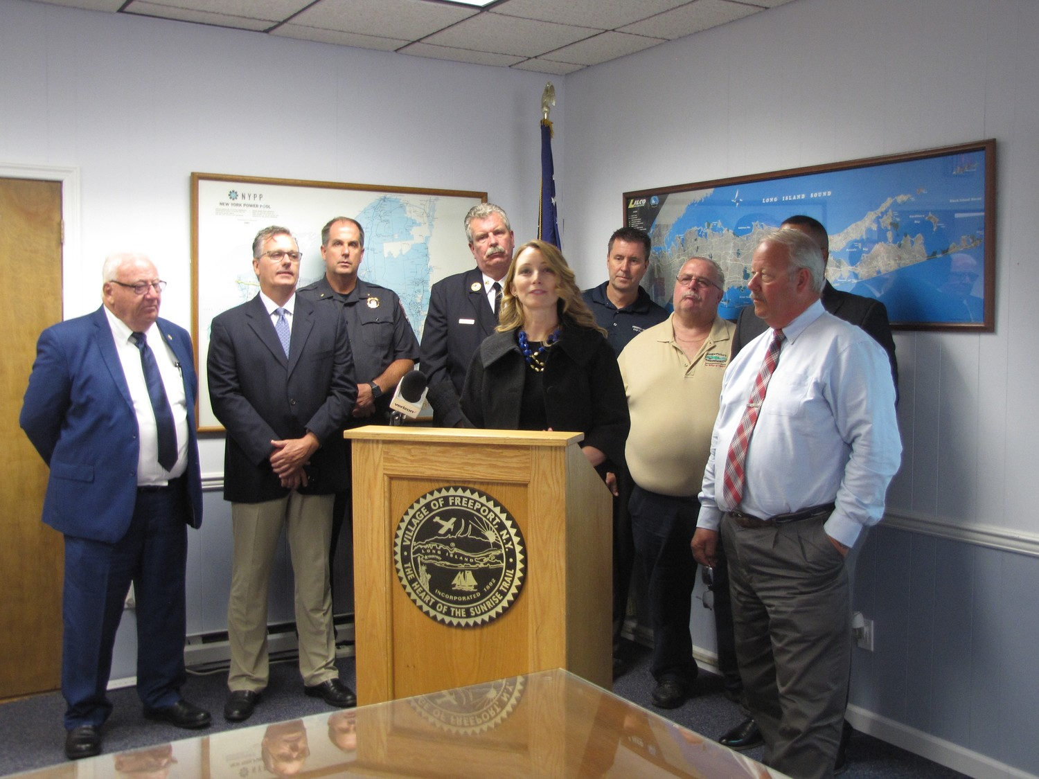 Emily Thompson, deputy general counsel of the Governor's Office of Storm Recovery, with Mayor Robert Kennedy, far right, and representatives of Freeport's Department of Public Works, Freeport Electric and the police and fire departments, explained the new outage management system that the village will implement the first week of August.