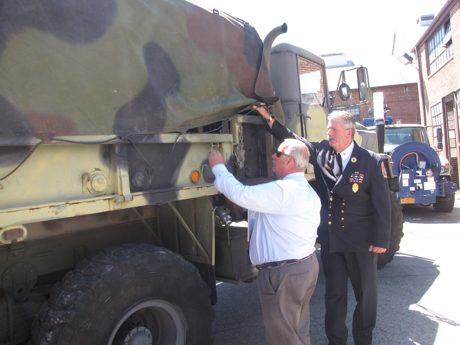 Kennedy and Ray Maguire, executive director of the Freeport Fire Department, inspected one of the village's emergency trucks.