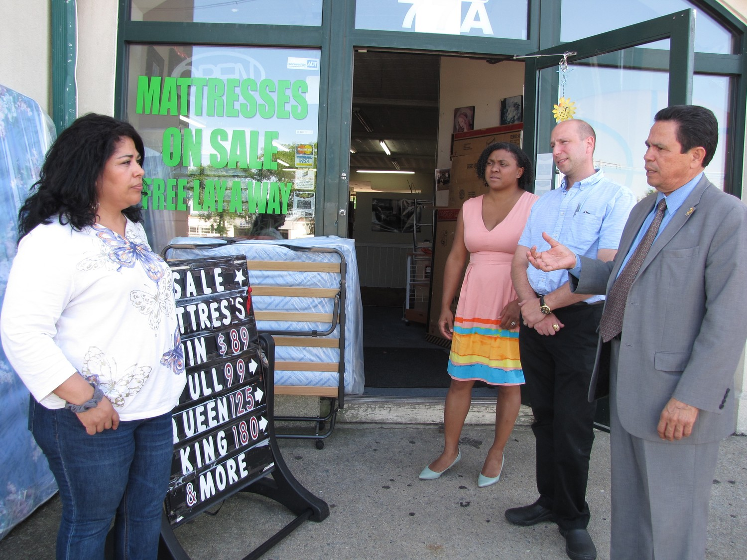Angelica Fernandez, assistant manager of Island Bedding, spoke with Jennifer Winters, Joseph Gambino and Cristobal Lopez about her efforts to keep the sidewalk in front of her store free of litter.