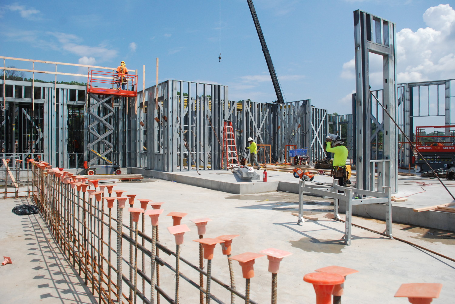 Laborers worked to erect what will eventually be the walls of the Beacon, a residential building set to be completed before 2020.