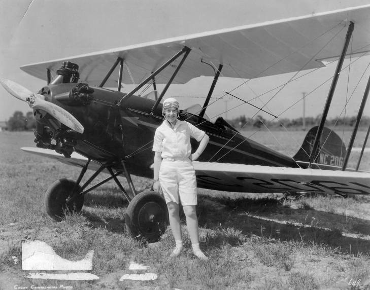 Smith with the Bellanca plane in which she set an endurance record of 26 1/2 hours in the air in 1929.