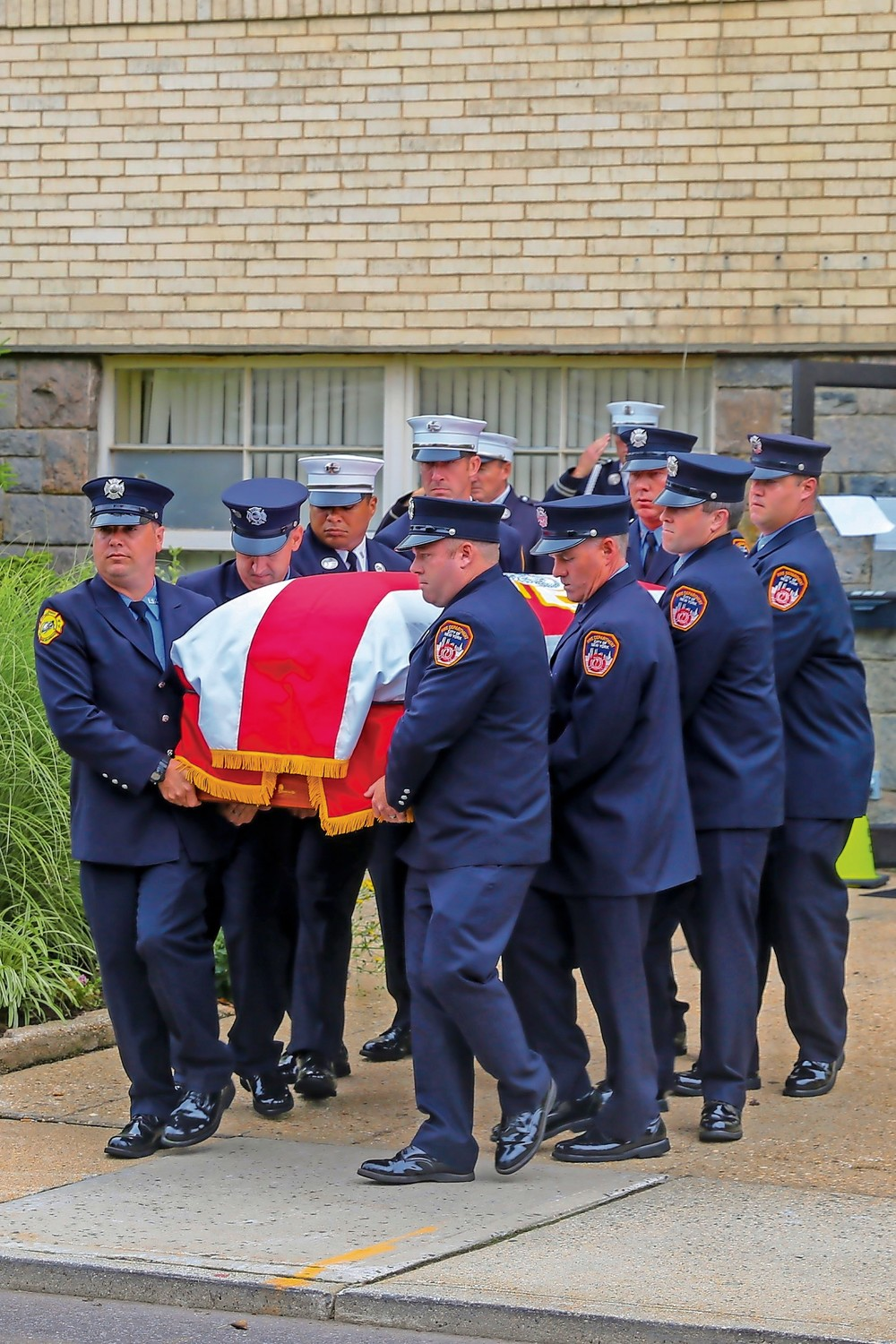 Members of the FDNY carried his casket out of the Bridge Church in Malverne.