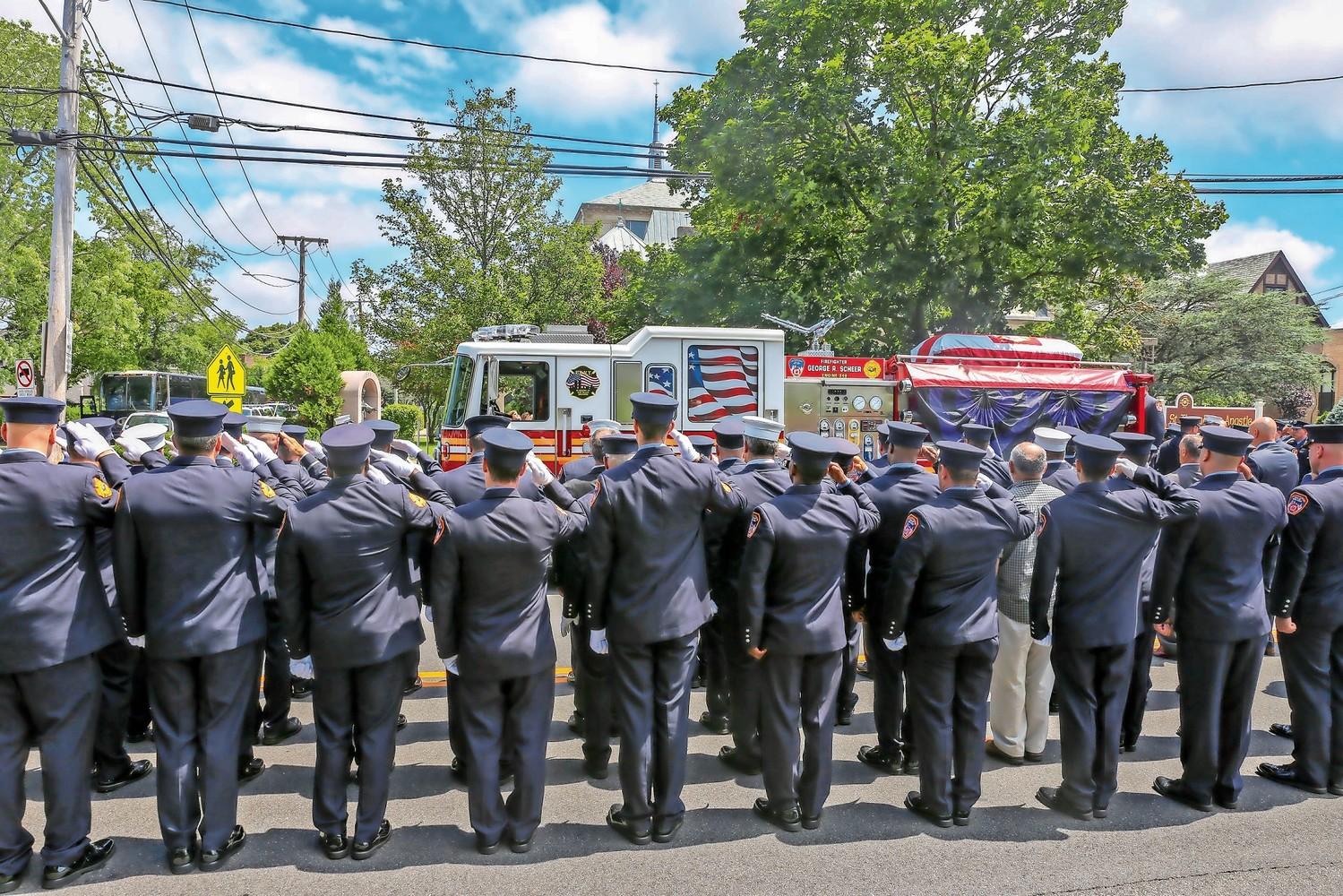Dozens of firefighters saluted George Scheer during his funeral on Aug. 1.