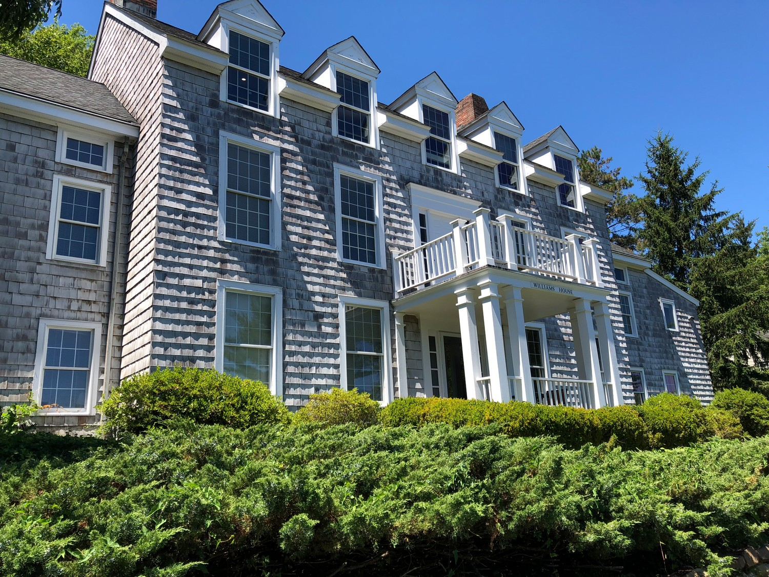 Many of CSHL's buildings look like they belong in a New England fishing village. Above, Williams House.